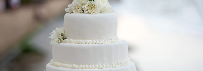 Religious liberty in an example of a white wedding cake with a blurred background.